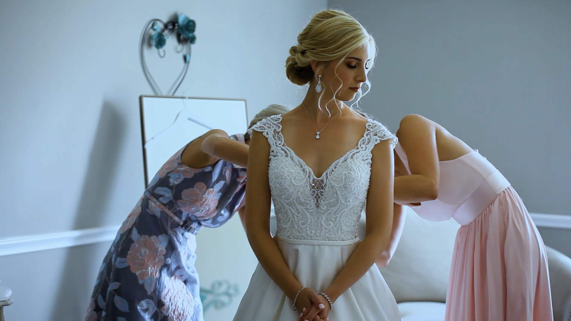 bride-putting-on-dress-not-white-balanced